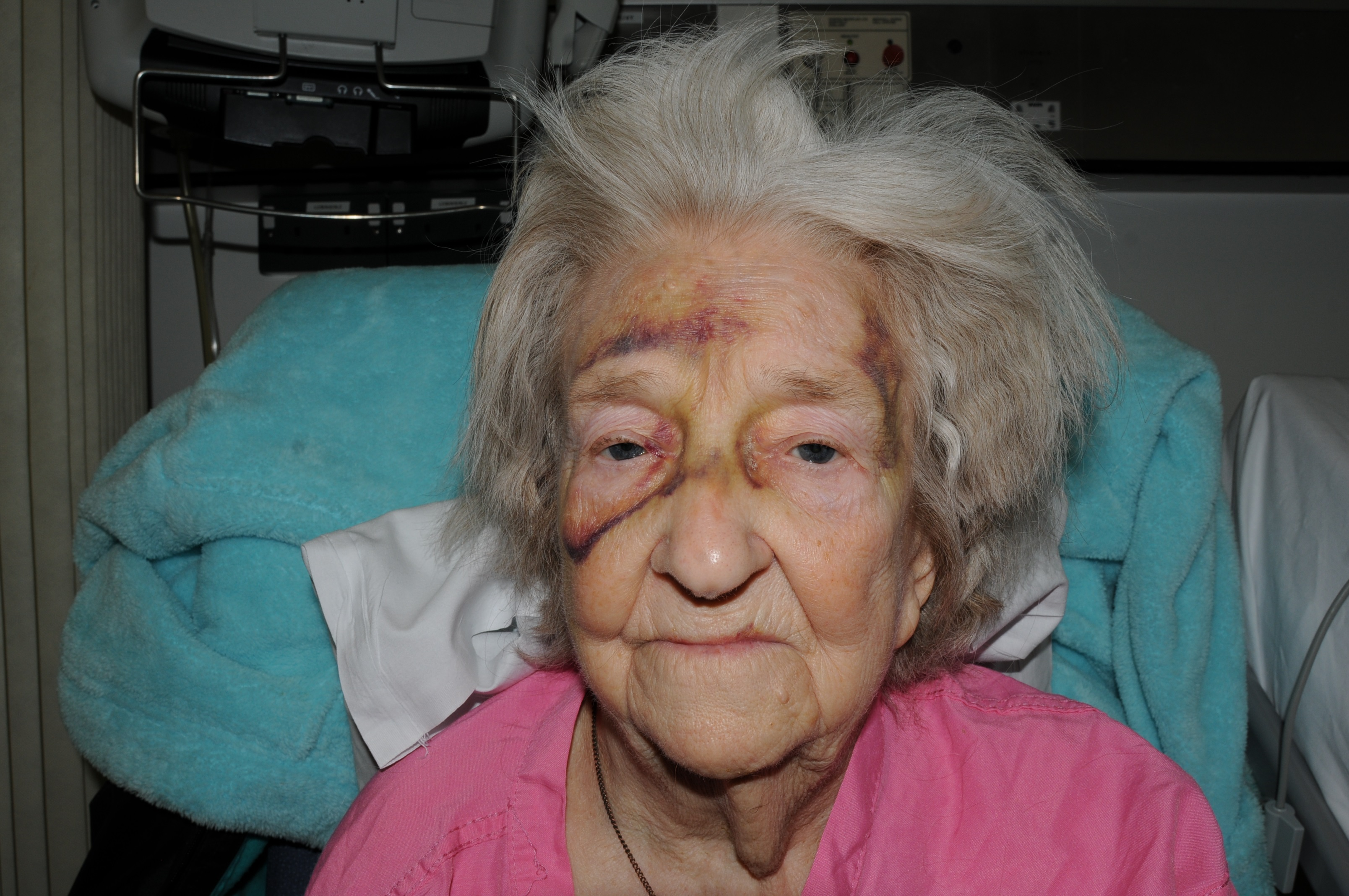 Police investigating the murder of an elderly woman from Stretford have arrested a man
