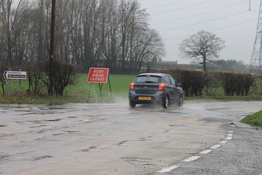 Car ignoring signage
