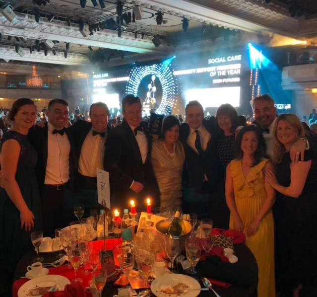 The New Care team celebrates its HealthInvestor award win
