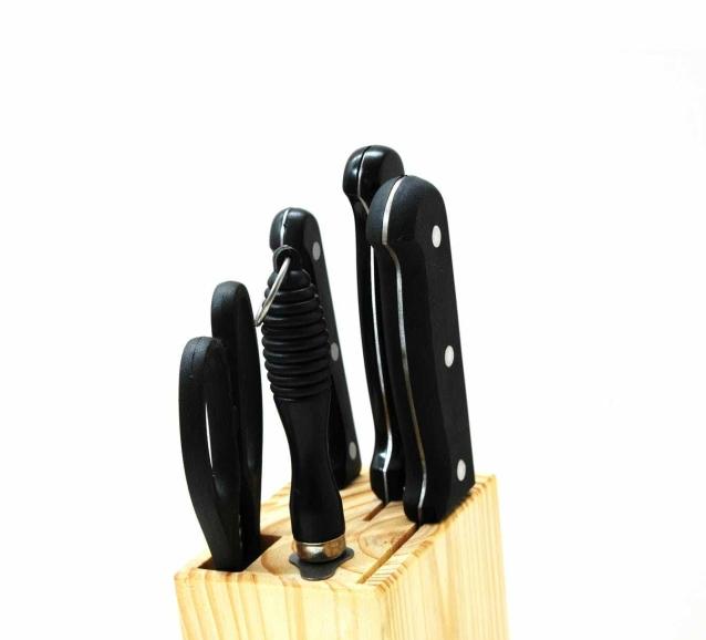 black handled kitchen knife on beige wooden pallet