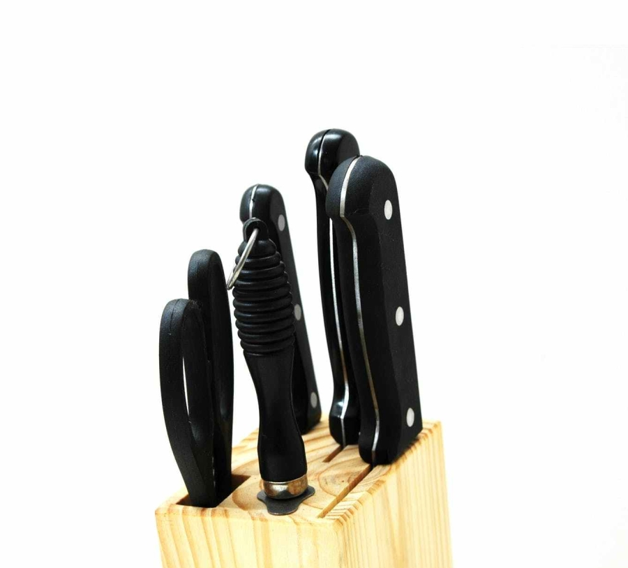 black handled kitchen knife on beige wooden pallet