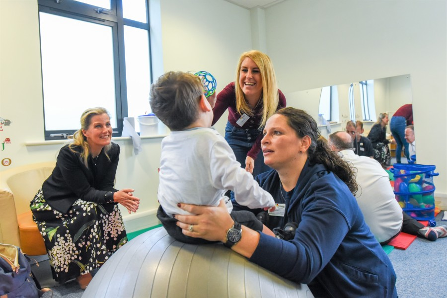 9. HRH watching a Physiotherapy demonstration with Nadia (NW Centre Manager and Paediatric Physiotherapist)